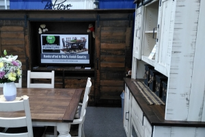 View of rustic entertainment center and dining set